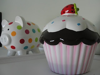I have the cupcake but I want the poka dot one. cute!!