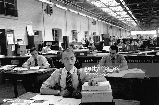 Men working in an office.