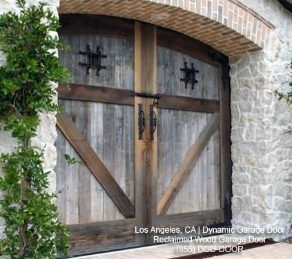 custom handcrafted garage doors in a tuscan style garage and shed los angeles dynamic garage door