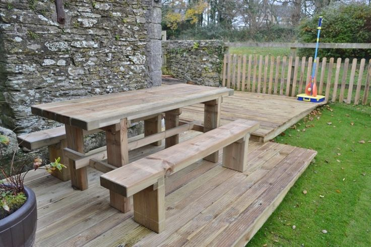 Decked Patio - outdoor rustic furniture, garden furniture. Wooden bench and table, picnic table, bbq table.