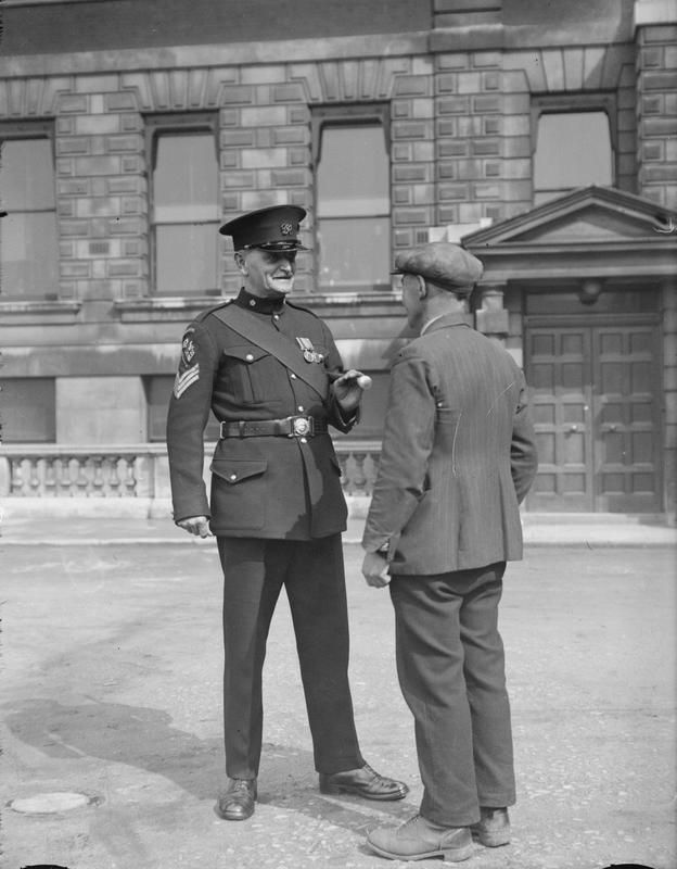 """A British Army ramrod recruiting Staff Sergeant having a """"recruiting"""" talk with a prospective Tommy at an army depot shortly before the outbreak of WW2. Britain entered the war with a volunteer army that suffered defeat after defeat in the early stages of the conflict. Full conscription was introduced almost immediately after Sept 1939, but the full-strength British Army did not come into play until late 1942."""