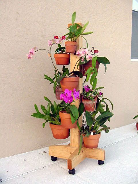 "DIY  idea for designing vertical container gardens with orchids, miniature roses, herbs, african violets, bromeliads..any collection of plants...Create more space, less clutter around the patio or deck.  Hangapot hangers securely hold  4""-10"" clay pots, any weight on any surface...Grand dad or handyman can build the pole...hangapot hangers install in seconds...last a lifetime and are made in America.  More ideas www.hangapot.com  9 flower pot hangers for $29.95       Flo"