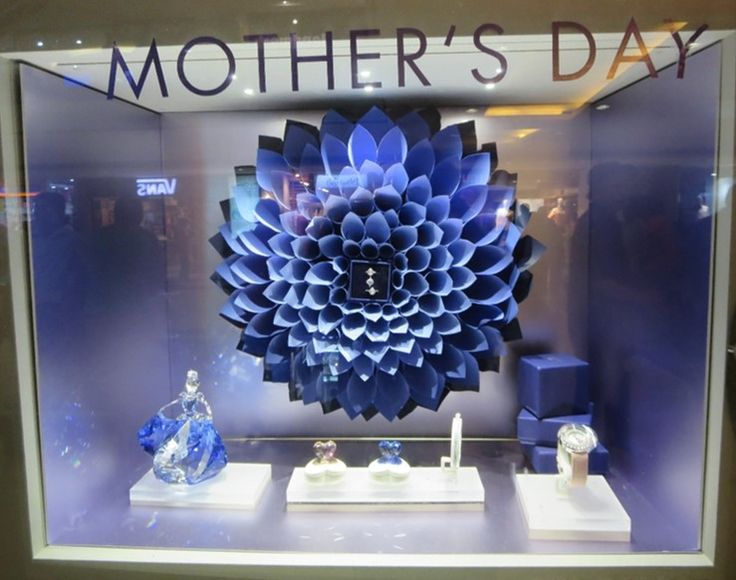 CRYSTAL BLOOM! Neat composition of an intricate paper flower arrangement and gift boxes to draw attention to the romance of Swarowski mother's day crystal gifting adornments does catch the eye and tugs at the heart!