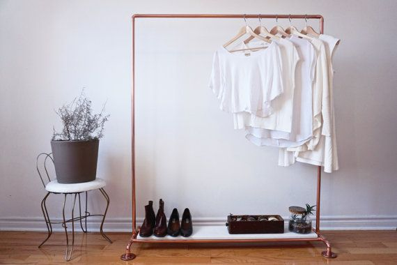 This copper clothing rack features a Carrara marble shelf along the bottom. The 3/4 thick slab of marble is hefty, the same thickness that is used