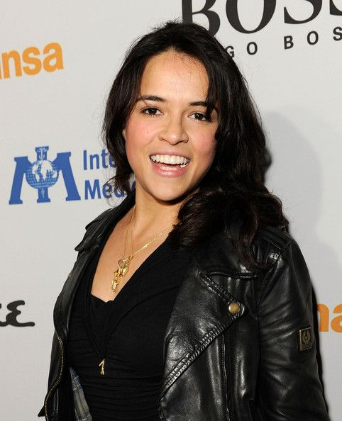 Michelle Rodriguez Medium Wavy Cut with Bangs - Michelle Rodriguez sported a youthful wavy 'do with bangs at the grand opening of Esquire House LA.