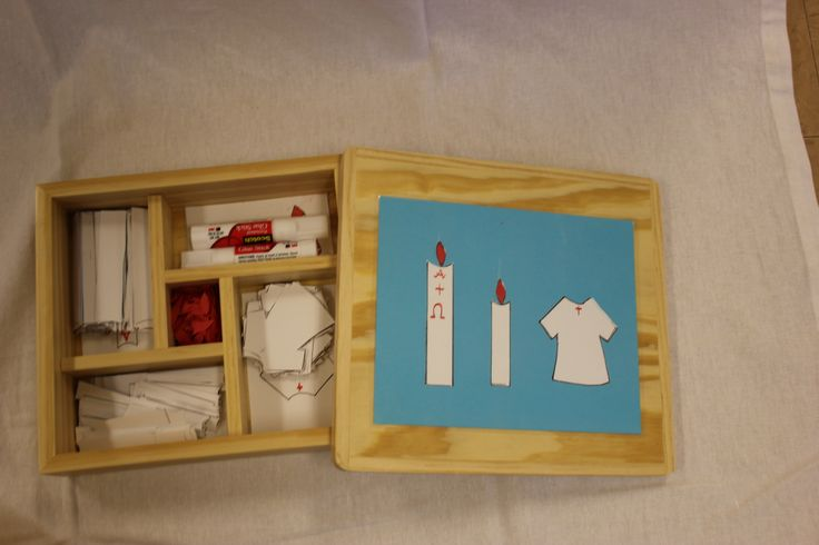 A related work for baptism in a CGS atrium for 3-6 year olds is to make a pasting of the three main items introduced to children in the first presentation on baptism: the light of Christ as represented in the paschal and baptismal candles and the white baptismal garment. This collage boxes was created by BC Woodshop in Las Vegas, Nevada.