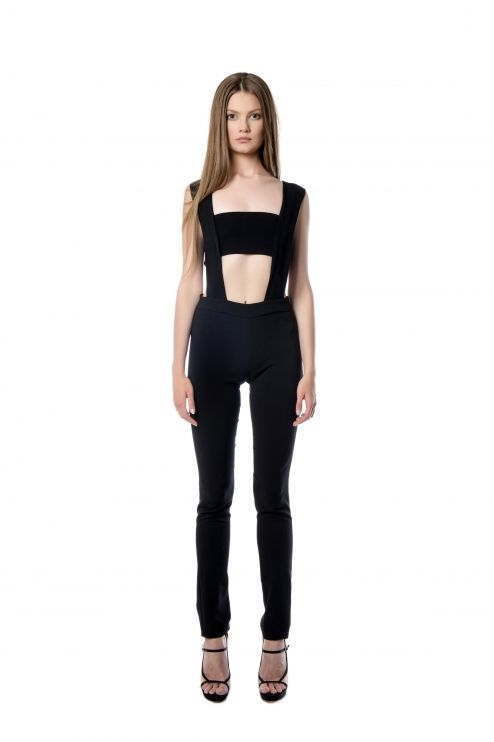 Slim fit jumpsuit  This slim fit jumpsuit will flatter your silhouette. Its design is crafted from black crepe. The sleek cutouts emphasize the narrowest part of your waist and the lightly boned at the sides too. Complete the look with statement accessories and high heels.