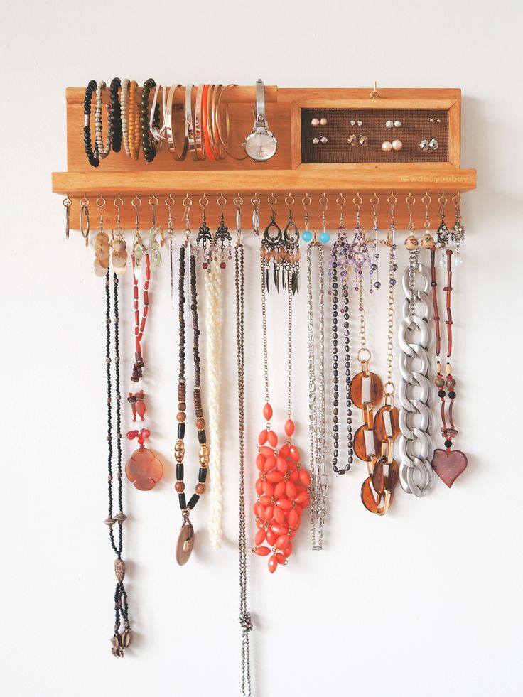 This is a wooden wall mounted jewellery organiser that is specifically made to declutter all your jewellery. No more tangled necklaces, mismatched earrings or lost bracelets! Have everything on display for us, ladies that are on the go!  Earrings holder - Bracelet holder - Jewellery holder - Necklace organiser - jewellery storage - jewelry holder - jewelry organizer - Necklace hanger - Wall mount jewelry holder - Necklace display