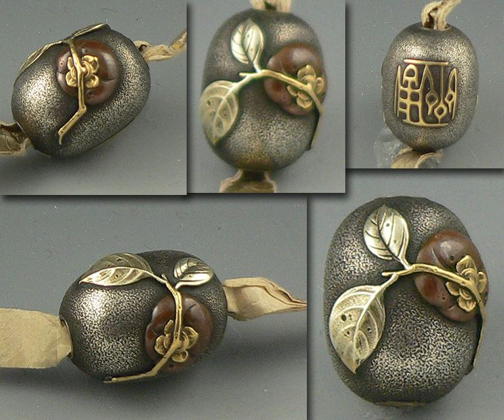 "Beautiful mixed-metal Ojime bead from Japan.  I believe that it is a ""kaki fruit,"" or persimmon, with branch and leaves.  My favorite part are the little holes in the leaf put there by the artist.  If anyone recognizes the signature, please let me know!"