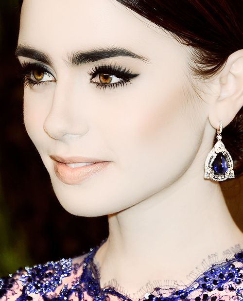Lily Collins: pale matte skin, clean contour, feline eyes, nude lip, strong natural brows
