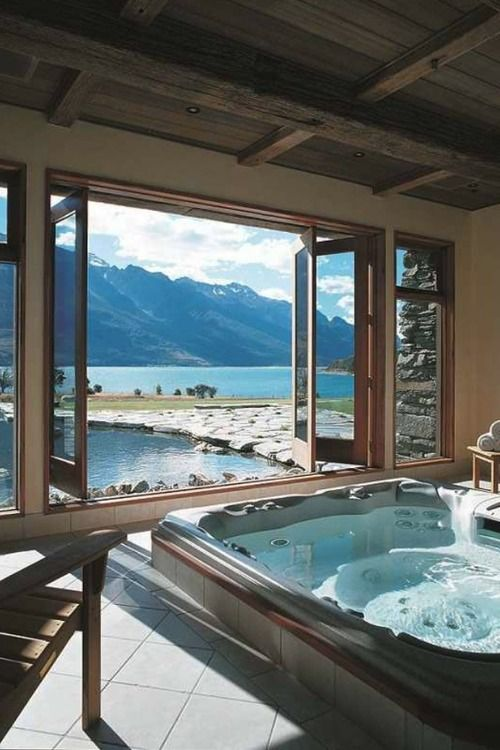Wouldn't this be heavenly. The mountain scenery, the bathroom with retracting windows to breathe in the air, and that tub big enough for two. Yummy!