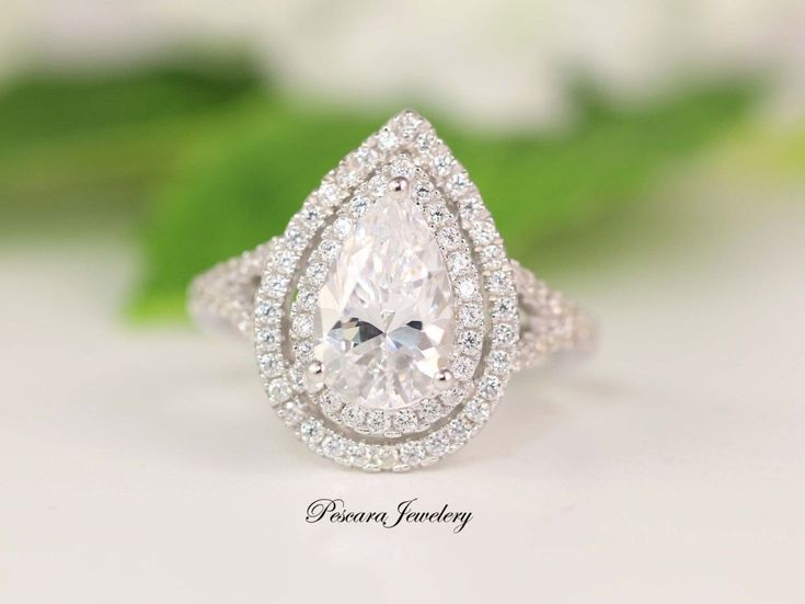 3 Carat CZ Ring, 3 Carat Solitaire, Pear Cut CZ Ring, Halo Ring, Pear Cut Halo, Halo Engagement, Double Halo Ring, Promise Ring, CZ Rings by PescaraJewelry on Etsy https://www.etsy.com/ca/listing/504302067/3-carat-cz-ring-3-carat-solitaire-pear