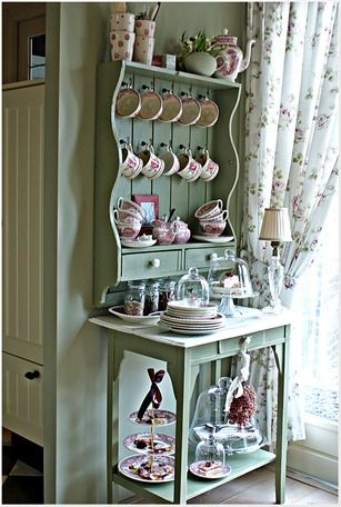Dining Room Display - mismatched wall cabinet and an old sewing table, when painted the same color, make a pretty, open display - via Just Jeanette