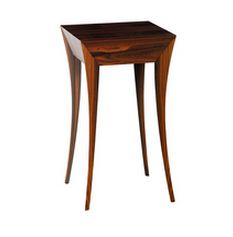 Based on the fountain in its movement and shape, this Elegance side table is slim and elegant with an aspect of superiority which is typical of the elitist. Opening up to reveal a secretly concealed drawer for storage, this side table is the perfect piece to add to any entryway, hall, bedroom or living room.
