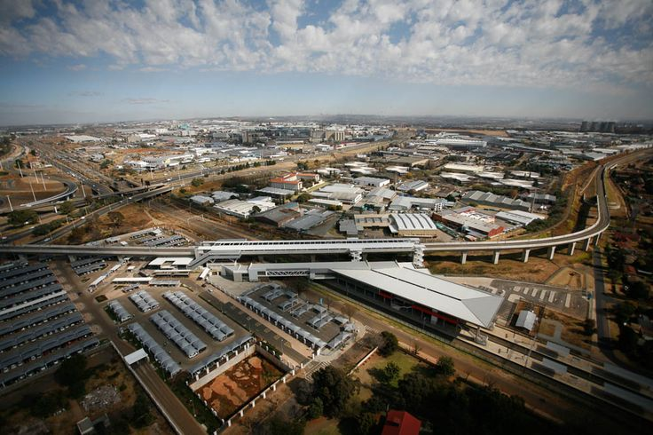 An aerial view of Rhodesfield Station, above the existing PRASA line, linking to Sandton in the West and Oliver Tambo International Airport just to the East.