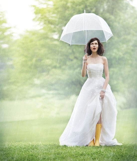Planning an outdoor wedding is risky but thats why you should have a white umbrella and Wedding rain boots just in case!