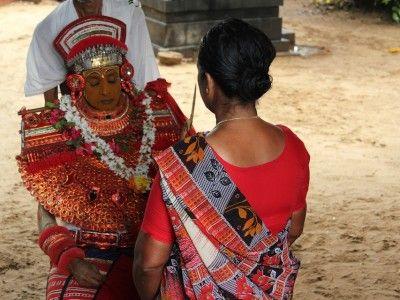Consulting the Theyyam, Tellicherry, Kerala, India