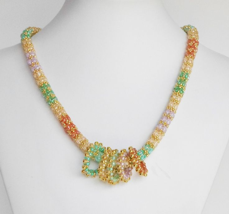 3050 My adaptation of Jill Wiseman's Daydreamer necklace.  I added five colorful beaded circles.   $105  by Darlene Pfahl