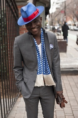 blue scarf and hat with grey suit