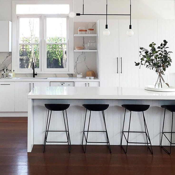This striking kitchen design by @littlelibertyrooms features bold black fixtures against a clean, fresh, white kitchen creating a beautiful contrast. These include truly unique pendant lights, matte black cabinet handles and our matte black kitchen mixer. meiraustralia#Meir #Meirblack #Meiraustralia #Blacktapware #Matteblacktapware #kitchenremodel #kitchendesign #kitcheninspo #interiorstyle #interiorinspo #interiorandhome #renovationideas #pendantlight #monochromelovers #architecturelover