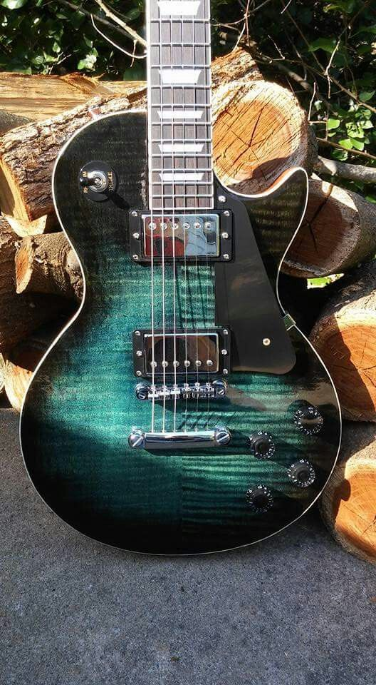 Chitwood Camino. A combination of liquid Rit dyes in aquamarine and black with a final aquamarine wash and tru oils along with a walnut MinWax wiping gel stain make this Les Paul copy known as The Camino pop by guitar builder/luthier Rodney Chitwood.
