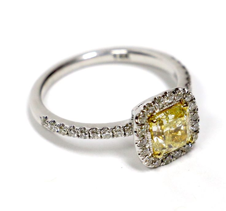 A genuine canary diamond beautifully framed by its friends. Find it on WhiteCarat.ca!
