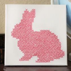 Cross-stitch this cute little bunny onto an artist's canvas to make cute Easter decor!