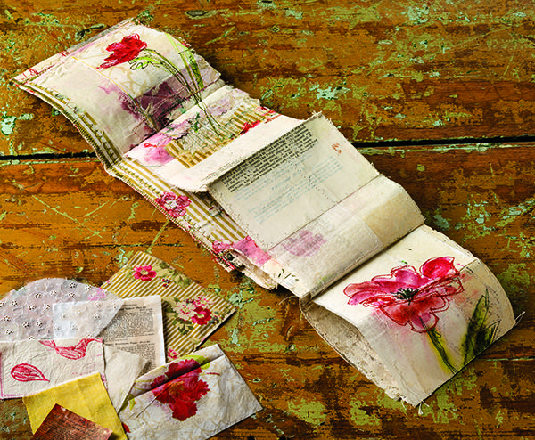 Vintage materials made into an accordion book, featured in Cloth Paper Scissors magazine