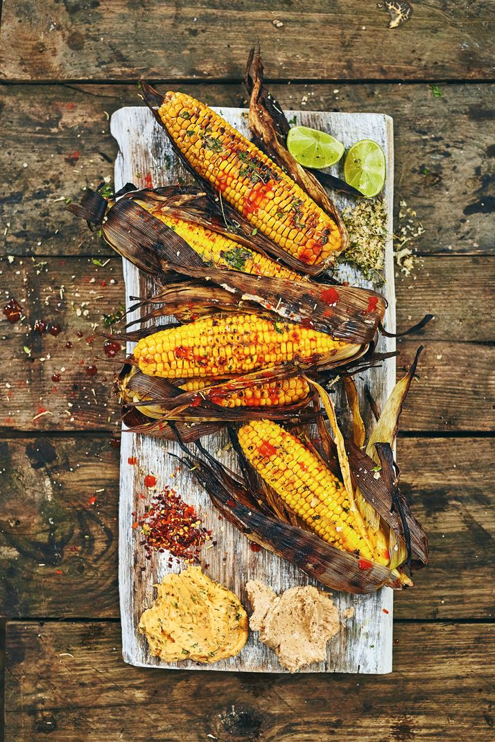 Grilling corn over flames gives the kernels a mellow toasty flavour that makes each ear the perfect recipient for flavoured butters and barbecue sauces. Soaking the ears of corn in water, still in their husks, before grilling steams the corn and stops the husks burning, and brushing the soaked ears with fat before they go...