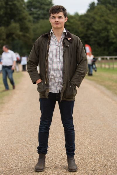 We bumped into Henry enjoying this year's Game Fair wearing his treasured Barbour Wax Jacket – styled with a checked shirt and denim jeans.