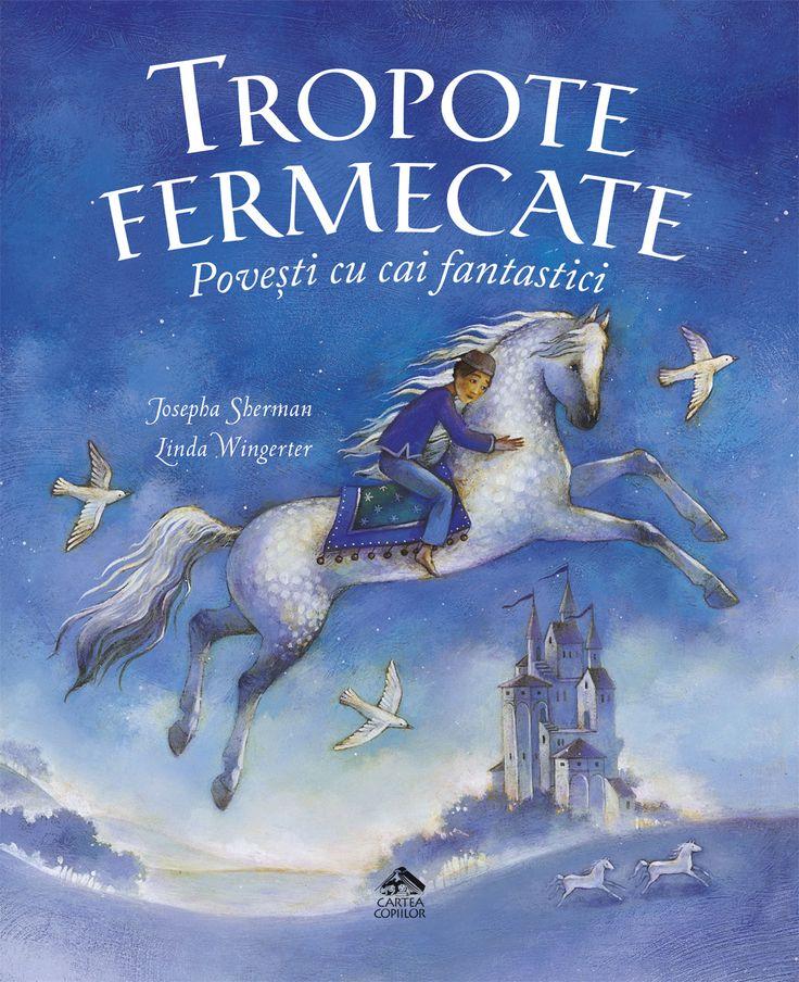 """Mărturisesc că nu căutam în mod special o carte despre cai și nici nu ne plăceau în mod special caii. DAR, """"Tropote fermecate. Povești cu cai fantastici"""" promitea să ne ducă prin lumea întregă și să descoperim aventuri cu căluți. Și promisiunea nu a fost încălcată nici de conținut și nici de ilustrații. Cartea ne-a atras de la copertă, iar mirosul de proaspăt tipărit ne-a încântat simțurile. Am răsfoit cartea înainte de a o citi, pentru că nu știam ce poveste să alegem prima. Apoi am scos o…"""