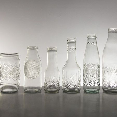 Upgrade by Tomas Kral. The collection takes processes used to engrave and gild crystal glass and applying them to industrial jars and bottles.