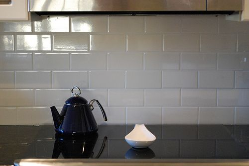 basic white subway tile in kitchen with white grout.