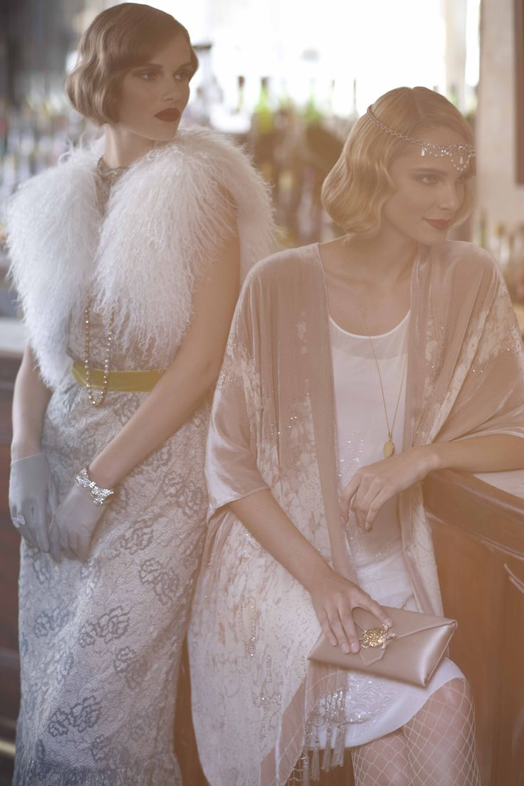 I love this entire look, perfect hair, kid gloves, sparkling headband, and fur vest!    Northern Lands Vest and Enfumé Wrap from BHLDN