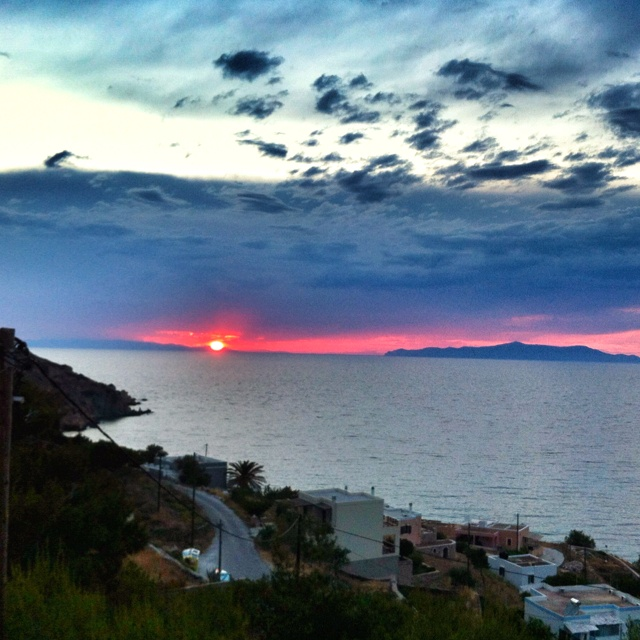 Sunset at Kini Village view from Pino di Loto luxury Apartments