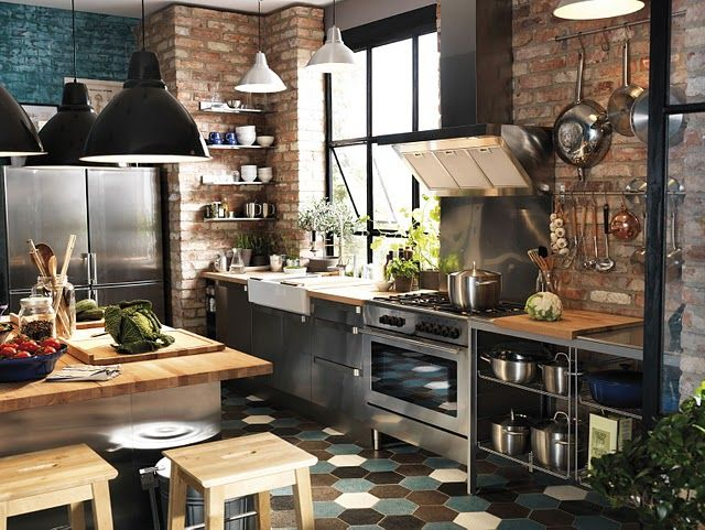 I love the open feel of this kitchen, the exposed brick walls and windows.