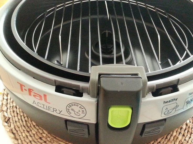 """**HOW TO MAKE YOUR T -FAL ACTIFRY MORE VERSATILE** - (Purchase a 9 1/2"""" round cooling/baking rack and gently pry the center of the rack apart so the mechanism still turns but does not touch the rack) - Voila! you now have another level . You can now bake two levels of delicate foods or add last minute foods to the top rack♥ TIP: Slightly tip the rack to go under the front lip and then press down GENTLY ON THE BACK.- Your rack will not move around if it is 9 1/2 """"!!"""