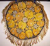 This antique Hungarian Matyo folk embroidery round tablecloth   dates from the 1920s.