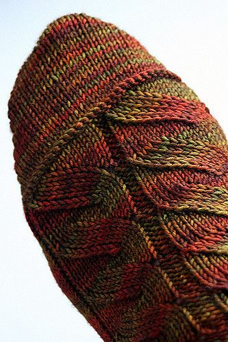 Nutkin is an easy to memorize pattern with dramatic results. Although the pattern includes many YOs, the sock does not appear lacey. Great for subtle striping yarns, like the one pictured here.