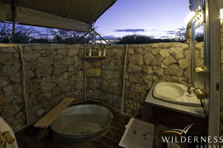 Andersson's Camp - The en-suite bathrooms continue the unique design. #Safari #Africa #Namibia #WildernessSafaris