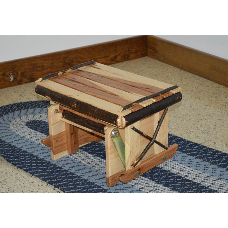 Hickory ottoman. This gliding ottoman is perfect to use with the Glider Rocker. Made with real hickory sticks and rustic hickory slats. FREE SHIPPING