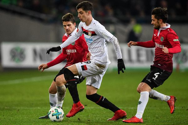 Kai Havertz Photos - Edgar Prib #7 of Hannover 96 (L-R), Kai Havertz #29 of Bayer Leverkusen and Julian Korb #4 of Hannover 96 battle for the ball during the Bundesliga match between Hannover 96 and Bayer 04 Leverkusen at HDI-Arena on December 17, 2017 in Hanover, Germany. - Kai Havertz Photos - 7 of 130