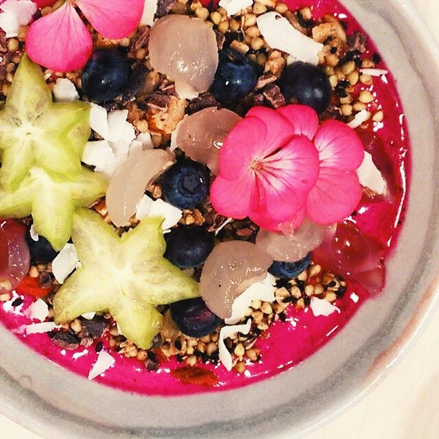Dragonfruit Smoothie Bowl with a smoothie base of pink dragonfruit, berries, banana, coconut milk and coconut yoghurt; topped with a buckini granola, cacao nibs, flaked coconut and fresh fruits. Hunters' Roots Cafe 26 Katherine Place Melbourne 3000. Photo by The Food Society.