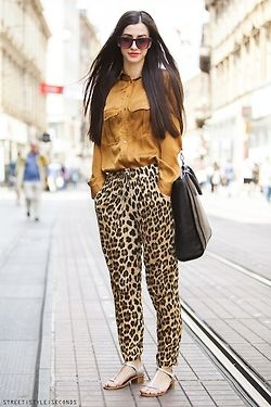 Printed pants are an easy way to add a little bit of wow factor to your outfit. Try some leopard print pants for a cool everyday look. This stunning lady was photographed by Street Style Seconds. She wears her drawstring leopard print pants with a mustard coloured shirt and block heeled sandals. This is a smart daytime look but you could also dress it down with a slouchy singlet and floppy wide-brimmed hat.
