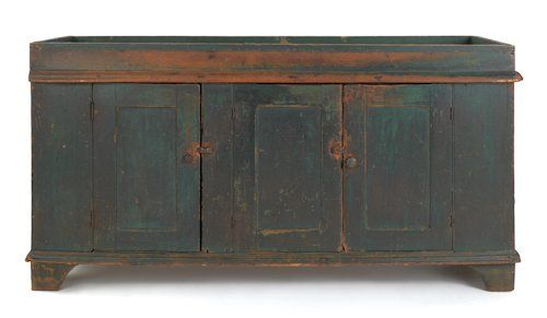 Sold For $4,000       Large Pennsylvania painted dry sink, 19th c., with a well above three doors and straight bracket feet, retaining an excellent old green painted surface, 31 1/2'' h., 60 1/2'' w.      Condition report    Sporadic abrasions. Tack holes around edge from liner.