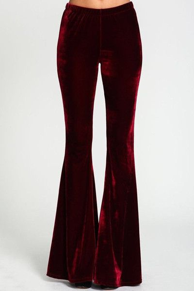 """- Burgundy Velvet Bell Bottoms Elastic waistband - 43.5"""" length - 26"""" waist - 34"""" inseam - measured from a size small - 100% Polyester - Made in the USA"""