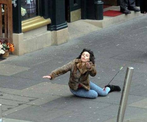 Scarlett Johansson Falling Down With an Arrow In her Leg  ---- funny pictures hilarious jokes meme humor walmart fails