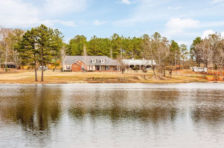 CLICK2TOUR this beautiful horse farm in north Tallassee. 23+ acres, 4BR/2.5BA/3229SF home, barn with stalls & tack/feed room (and tall enough to park a large RV), field sheds, sand arena, exercise walker, lake, creek, and spectacular views. For more details, call/text Slade & Kim McElroy, 334-221-1759 or 334-277-8920, Keller Williams Realty. Photos & tour by Sherry Watkins…I Shoot Houses…http://www.Go2REassistant.com/VirtualTours.htm