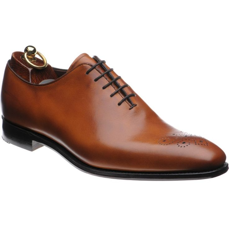 The Herring Macdonald is a beautifully crafted wholecut shoe of the highest quality comprising chestnut leather with a medallion of toe punching. Crafted on the elegant 205 last each pair is hand burnished for an individual touch. Wholecut shoe