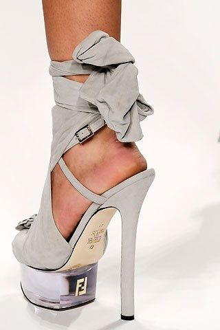 Fendi, I love Fendi, It's just my opinion I don't understand why a woman would wear a shoe like this...it can't be comfortable...it looks like you would break your ankle, so I ask...why?